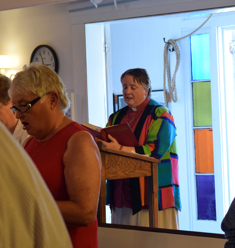 Pastor Kelly Harvell sings the final recessional hymn at the final service of the Round Pond United Methodist Church on Sunday, June 27. Approximately 43 people gathered to celebrate the life of the church and reflect on its 168-year history. (Evan Houk photo)