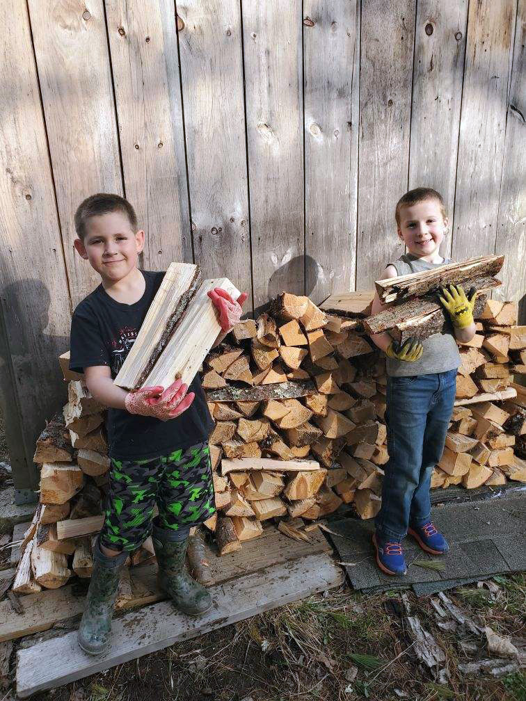 Best friends Zachary Hoppe (left) and Ryan Parson (right), both 7, recently started a new business selling camp firewood at 77 Biscay Road in Damariscotta. (Photo courtesy Jessica Hoppe)