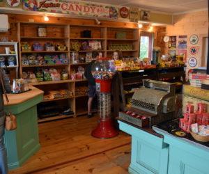 Customers shop in the newly renovated and reopened S. Fernald's Country Store in Damariscotta on Friday, June 25. The store is again open to walk-in traffic and offers novelty toys, nostalgic candies, pastries, and coffee from Rock City Coffee Roasters. (Evan Houk photo)