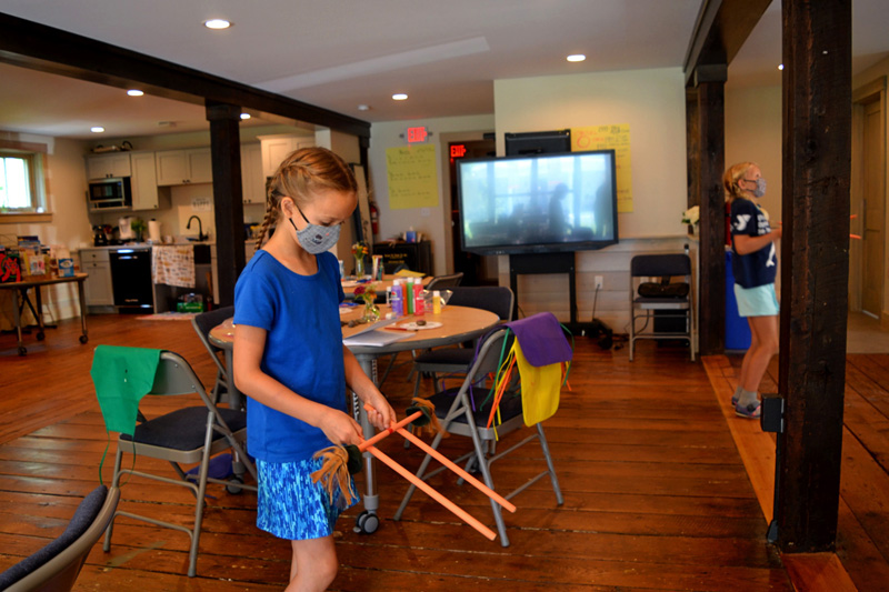 A camper practices with flower sticks inside the Merry Barn in Edgecomb on Friday, July 16. (Nettie Hoagland photo)