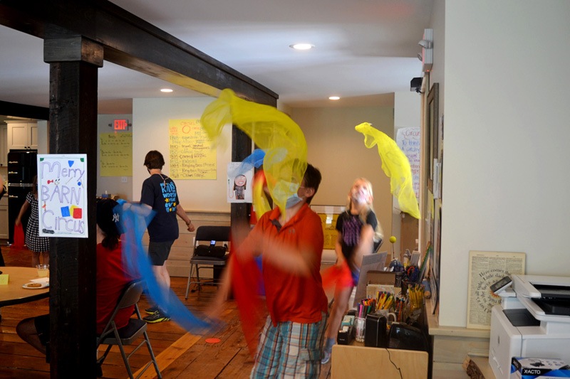 Camper juggles with scarves during the Under the Big Top camp at the Merry Barn in Edgecomb on Friday, July 16. (Nettie Hoagland photo)