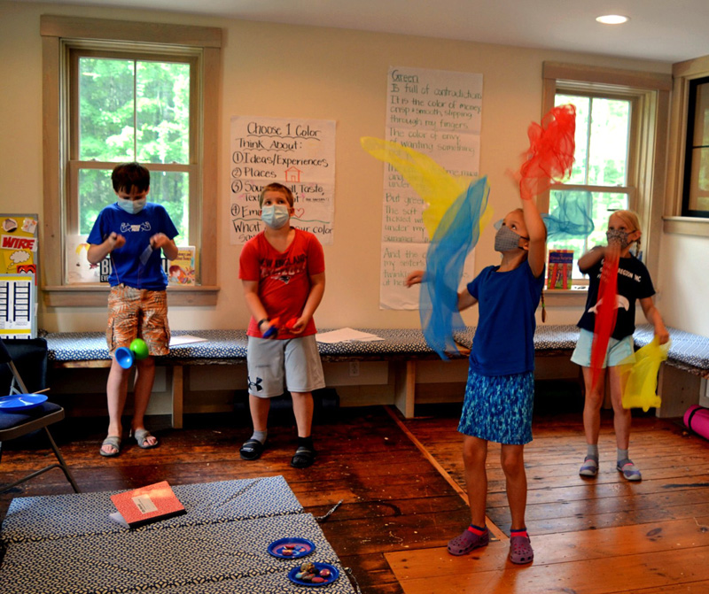 Campers juggle with scarves inside the Merry Barn during the Under the Big Top camp on Friday, July 16. (Nettie Hoagland photo)