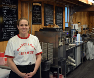 Mary Blanchard stands in Blanchard's Creamery, the ice cream and coffee shop she opened in Edgecomb over Memorial Day weekend. With free Wi-Fi and a cozy barn interior, Blanchard wants her business to be a summer hub in Edgecomb. (Nate Poole photo)