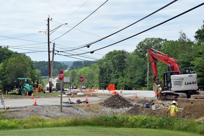 A construction crew works on the Maine Department of Transportation project at the intersection of Route 1 and Route 27 on Tuesday, July 13. The project involves installing a protected lane and islands at the intersection to allow easier access for traffic merging. (Nate Poole photo)