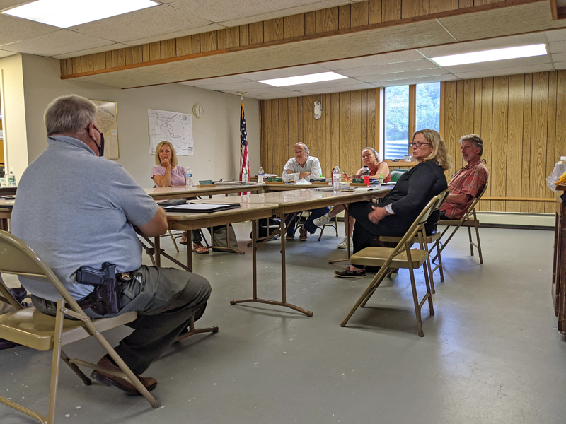 From left: Lincoln County Sheriff Todd Brackett discusses the excessive traffic on Route 27 and Eddy Road with recording secretary Barbara Brennan, Selectmen Ted Hugger and Dawn Murray, Rep. Holly Stover, and Selectman Mike Smith during the Edgecomb Board of Selectmen meeting on Monday, July 12. (Nate Poole photo)
