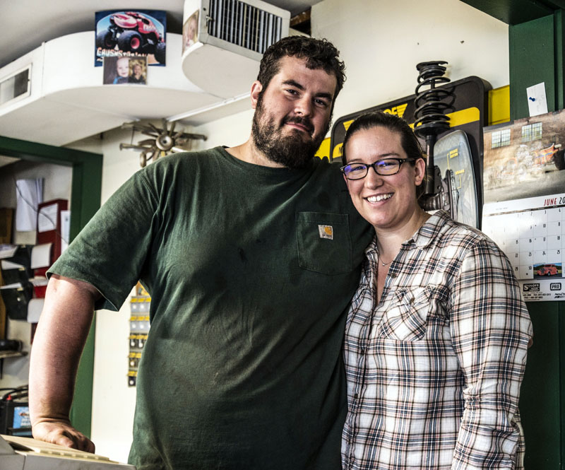 Steven and Kendra Reynolds stand behind the counter of All Seasons Automotive in Jefferson on Friday, June 25. Steven Reynolds is leaving the shop for a position with Bath Iron Works in Bath. (Bisi Cameron Yee photo)