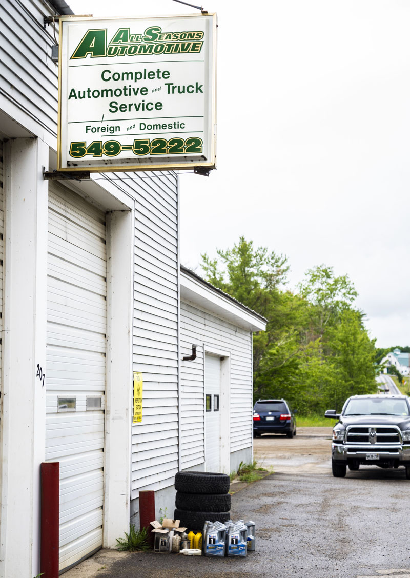 The All Seasons Automotive sign hangs above the four-bay garage in Jefferson on Friday, June 25. The shop will close its doors on Friday, July 2. (Bisi Cameron Yee photo)