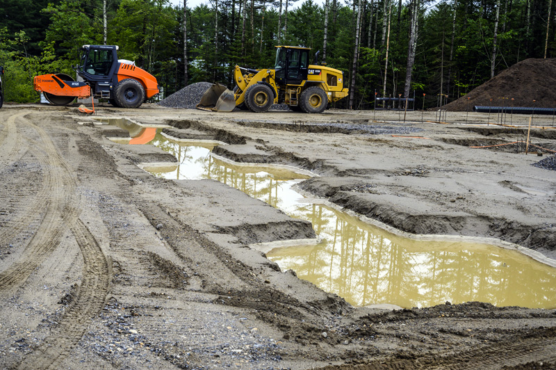 Construction vehicles are on hand to move dirt and gravel at the site of American Unagi's future aquaculture facility in Waldoboro on July 19. The innovative structure will allow elvers, or baby eels, to be raised to full size in a land-based facility. (Bisi Cameron Yee photo)