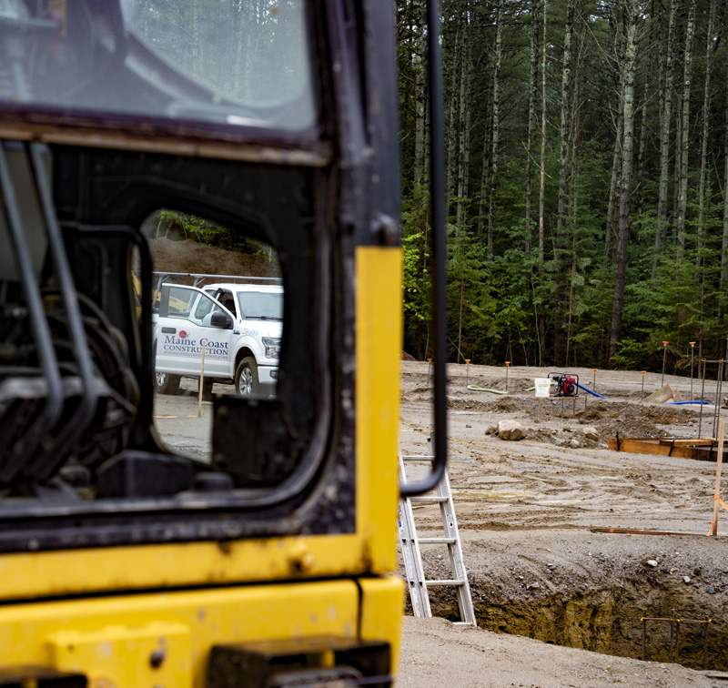 A Maine Coast construction truck is seen through the window of a construction vehicle in Waldoboro on July 19. The Camden company is the primary contractor for the construction of American Unagi's Waldoboro facility. (Bisi Cameron Yee photo)