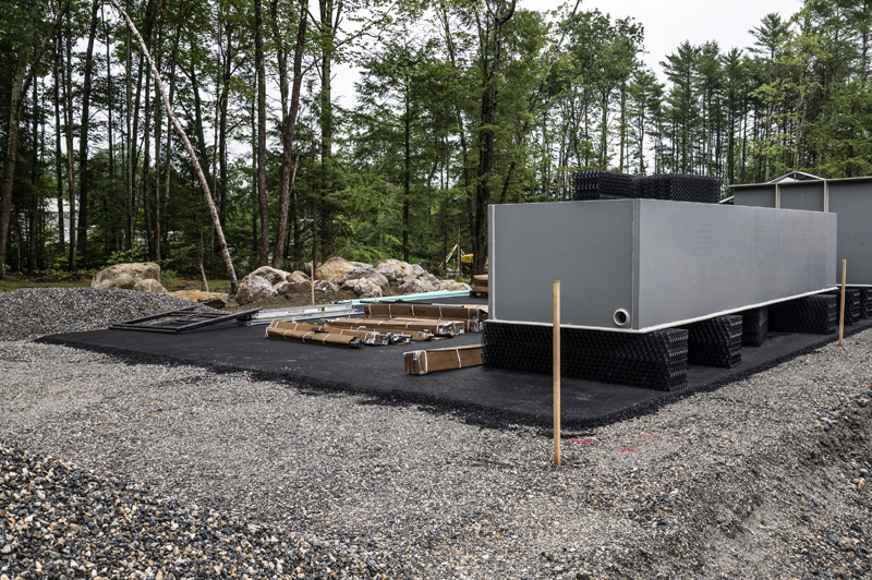 Large crates of material for American Unagi's recirculating aquaculture systems are beginning to be unpacked in Waldoboro on July 19. The system was designed by Dutch firm Aquaculture Consultant Engineering. (Bisi Cameron Yee photo)