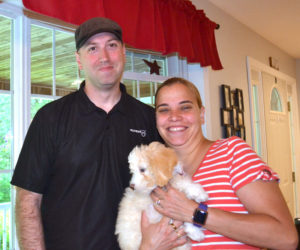 U.S. Air Force Lt. Col. Greg Ward, his wife Kristyna, and Stella, the family's new dog, enjoy a brief vacation in Nobleboro. Ward returned home from Kuwait on July 4 after a nearly 14-month deployment. (Charlotte Boynton photo)