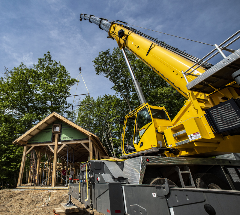 A crane installs the roof of an innovative house in Waldoboro on June 5.  The house is designed and built by CJ Turner, of Alpine Contracting Services LLC, based in Damariscotta.  (photo by Bisi Cameron Yee)