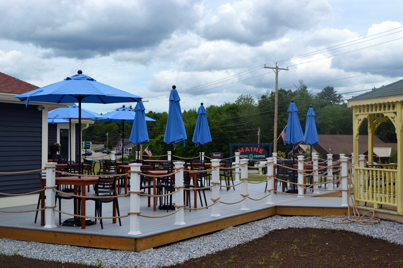 Visitors to the Maine Tasting Center can enjoy small plates and beverages at the outdoor seating area next to the tasting room. (Nettie Hoagland photo)