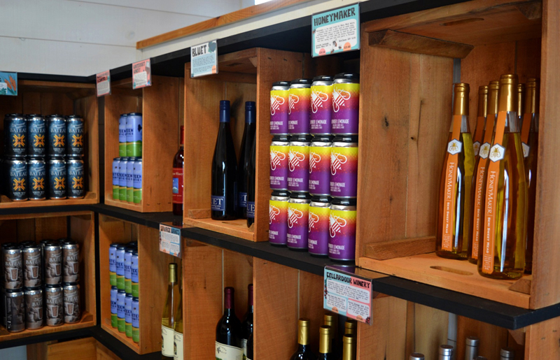 Some of the Maine-made wine, beer, and cider available inside the tasting room of the Maine Tasting Center in Wiscasset. (Nettie Hoagland photo)