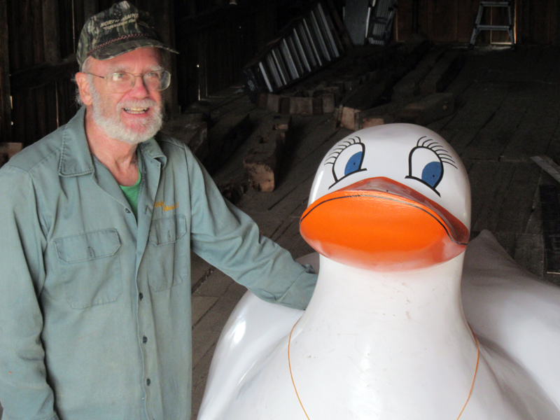 Pemaquacky, symbol of the Rubber Ducky Race, is welcomed to her new quarters by Phil Averill, race co-ordinator.