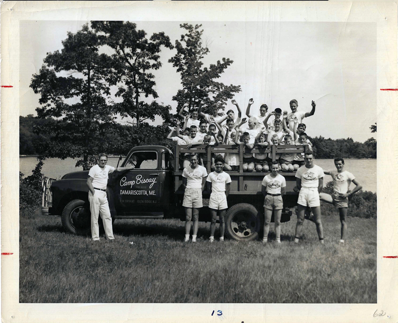 Camp Biscay Director Dick Bryant (L) standing alongside campers and counselors piled into the Camp Biscay truck. (Photo from Ivan Flye collection)