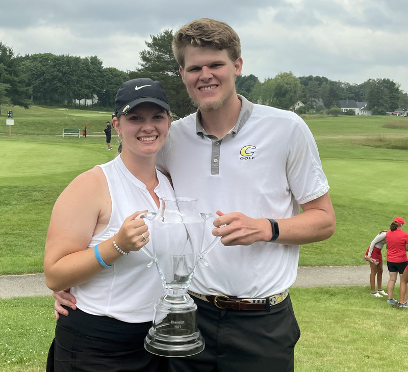 Bailey Plourde, of Newcastle, holds her Maine Women's Amateur trophy with her caddy and boyfriend Hans Stromberg. (Photo courtesy Lynne Plourde)