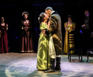 """Jenny Brown as Elizabeth Bennet and Ray Huth as Mr. Darcy finally kiss during Heartwood Regional Theater Company's dress rehearsal for """"Pride and Prejudice"""" in Newcastle on Wednesday, July 28. (Bisi Cameron Yee photo)"""