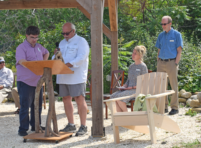 Mobius Inc. client and Damariscotta resident Matt Brough and Ed Porter, of Mobius, presented three handmade Adirondack chairs to the Audubon Society during a garden party at the Todd Wildlife Sanctuary in Bremen on Saturday, Aug. 7. Mobius also volunteers to help clear trails at the sanctuary. (Evan Houk photo)
