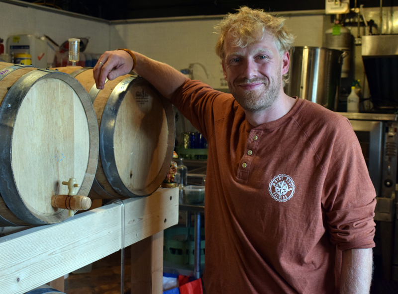 Chauncey Erskine, owner of Maine Booch, stands by a bourbon barrel from Split Rock Distilling  used to ferment his kombucha and make it alcoholic on Monday, Aug. 2. Maine Booch will be opening a tasting room at 85 Parking Lot Lane in the Damariscotta municipal parking lot from 5-9 p.m. on Monday, Aug. 9. (Evan Houk photo)