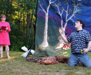 """Sam Inman as Bottom in River Company's production of """"A Midsummer Night's Dream,"""" performs a dramatic demise for Cally Green's Philostrate. (Nate Poole photo)"""