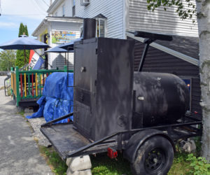 A food smoker sits in front of J & J Jamaican Grocery and Gift Shop at 88 Main Street in Damariscotta on Tuesday, Aug. 3. The town's Code Enforcement Officer issued a cease-and-desist letter for the smoker operations on Sunday, Aug. 1 after receiving complaints on Saturday, July 31. (Evan Houk photo)