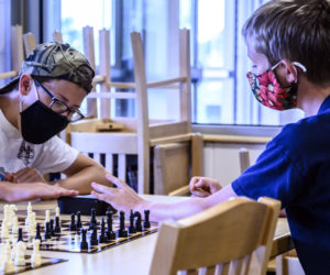 """Trevor Hall , 12, (left) and Cooper Powell, 11, play a timed match during a chess club meeting in Jefferson on Tuesday, Aug. 3. The two engaged in a playful """"super speed round"""" with only 30 seconds on the clock. (Bisi Cameron Yee photo)"""