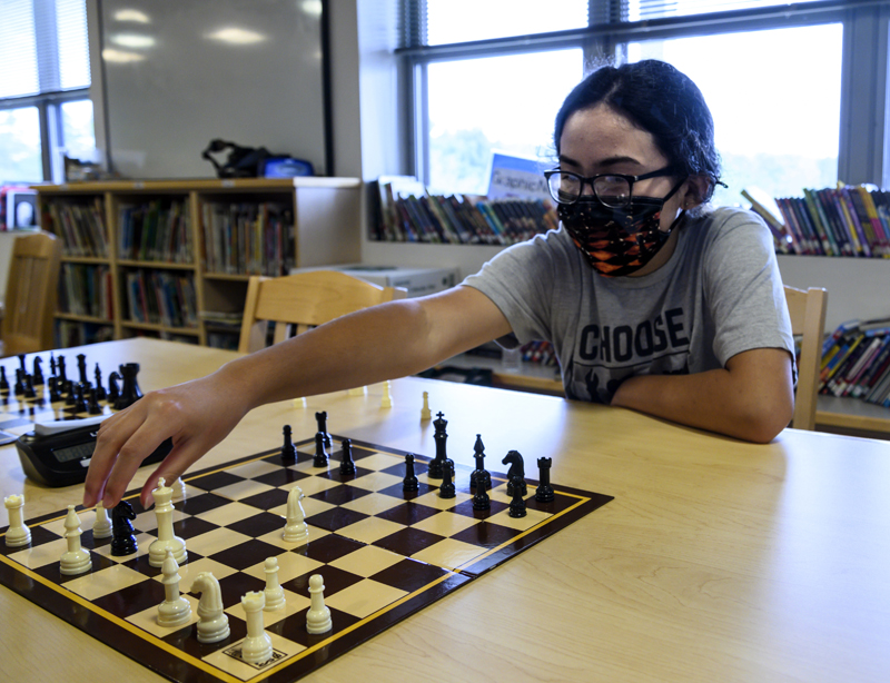 Shayla Pheng, 11, threatens the opposition's king during a chess club meeting in Jefferson on Tuesday, Aug. 3. Pheng has been playing for eight months and has a 1,200 rating at chess.com (Bisi Cameron Yee photo)