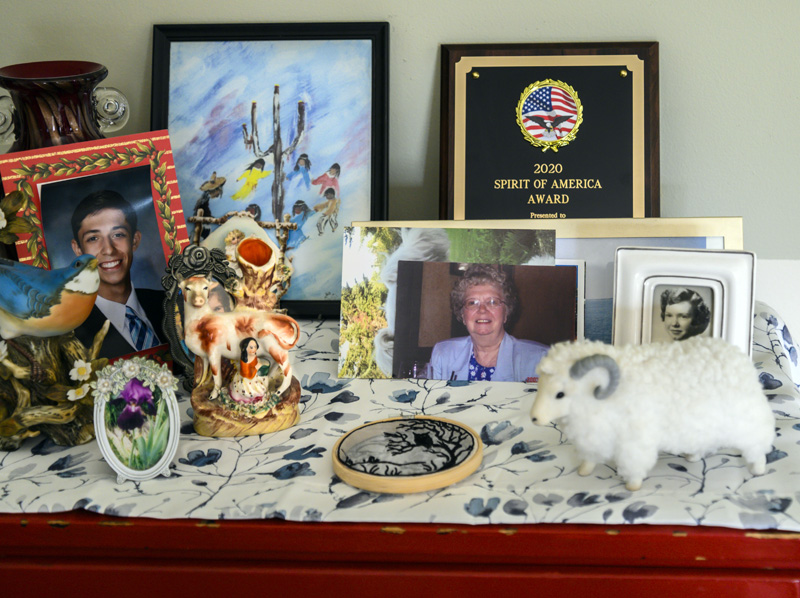 An array of photos, treasured mementos and the Spirit of America Award adorn a small table in Somervile on Friday, July 30. The Spirit of America was won by Somerville resident Ernestine Peaslee for her service to the town. (Bisi Cameron Yee photo)