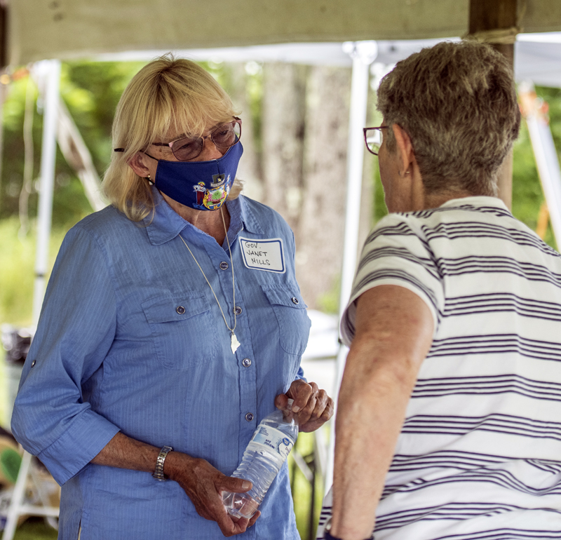 Gov. Janet Mills greets a constituent at the Lincoln County Democratic Committee's 2021 Family Fun Day Lobster Bake in Waldoboro on Sunday, August 8. (Bisi Cameron Yee photo)