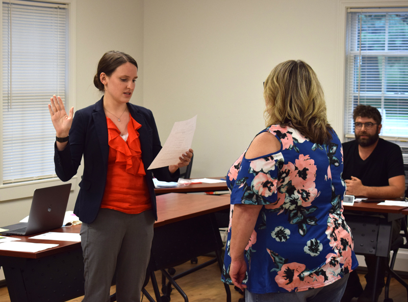Newcastle Town Manager Sarah Macy is sworn in by Town Clerk and Interim Town Manager Michelle Cameron as Joel Lind, chair of the Newcastle Board of Selectmen, looks on on Monday, Aug. 9. Macy, who previously was executive assistant to the city manager, mayor, and city solictor in Waterville, is Newcastle's second town manager. (Evan Houk photo)