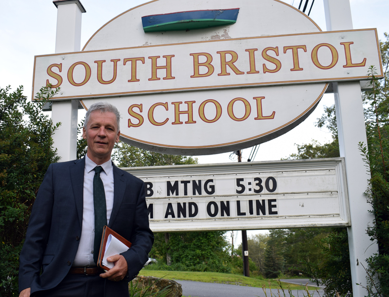 """Charles """"Chuck"""" Hamm stands outside of South Bristol School after being appointed principal at the South Bristol School Committee meeting on Tuesday, Aug. 3. Hamm previously worked as superintendent and head of school for Islesboro Central School for three years and he said he hopes to finish his career at SBS. (Evan Houk photo)"""