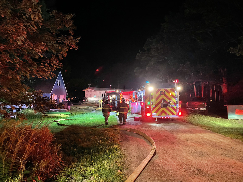 Fire fighters approach the scene of a house fire on Hilton Road in Whitefield, on Friday, Aug. 13. (Raye Leonard photo)