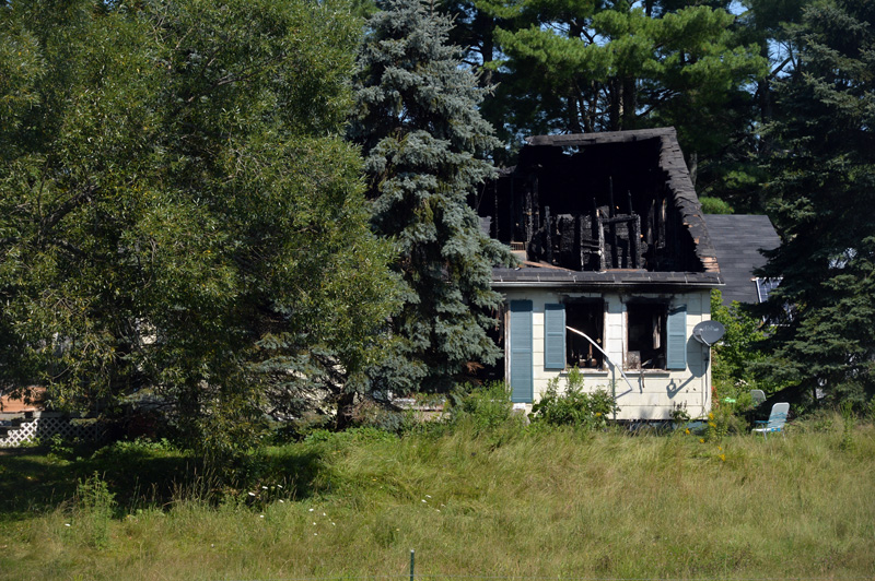 A fire severely damaged a two-story farmhouse at 736 East River Road in Whitefield during the early hours of Thursday, July 29. (Paula Roberts photo)