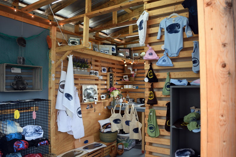 """While """"Mr. and Mrs. Claws"""" started IndustrialME to sell their functional steel artwork, they have slowly broadened their product line over their nearly three years in business to include branded clothing, placemats, photography, bags, and other merchandise. (Nate Poole photo)"""