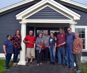 Wiscasset Area Chamber of Commerce members joined in Maine Tasting Center owners in the ribbon-cutting ceremony on Tuesday, Aug 3. From left: Datvik Deirkrikorian, Monique McRae, Chip Davidson, owners Elizabeth Gross, Andrew Gross, Sarah Gross, and David Flynn, Russell Cloutier, and Cheryl Rust. (Charlotte Boynton photo)