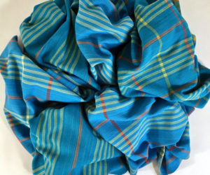 Colorful handwoven kitchen towels by Linda Healy.
