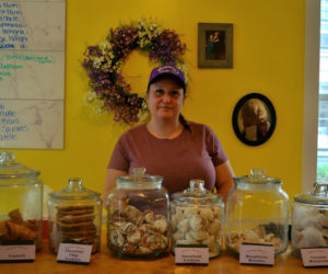 Jessica Deshiro, owner of Mammy's Bakery in Wiscasset Village, stands behind a case of homemade Italian pastries. (Photo by Nettie Hoagland)