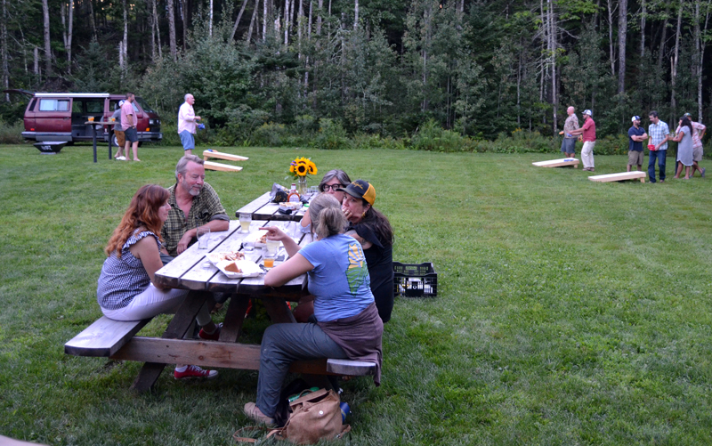The Tin Top Cider Co. tasting room offers plenty of outdoors seating and yard games, such as cornhole. (Maia Zewert photo)