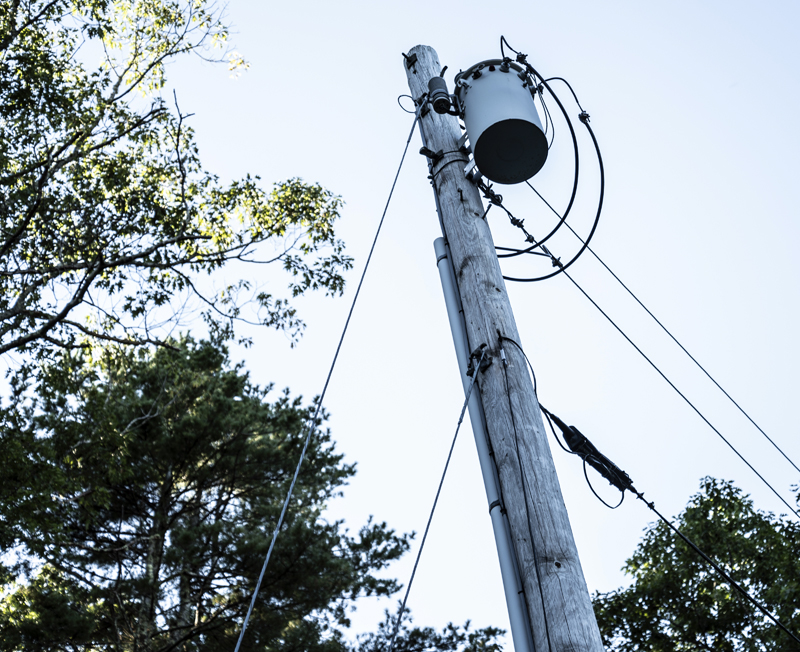 Wires lead to a pole-mounted transformer in Bremen on Tuesday, Sept. 7. A fiber optic sensor is being installed on poles in the community in order to bring broadband connectivity to unserved or underserved residents. (Bisi Cameron Yee photo)