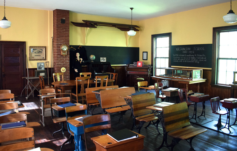 """The interior of the second floor of the Washington School in Round Pond has been restored by the Round Pond Schoolhouse Association as a museum that replicates a classroom in the historic 1885 building. William """"Bill"""" Smith, who attended the school from 1938 to 1946, was one of the founding members of the nonprofit and still gives tours of the school today. (Evan Houk photo)"""