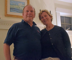 """Owners of the Harbor View House in Round Pond, James """"Jim"""" and Sarah Matel, stand inside the hearth of the common area during an open house on Sept. 26. (Evan Houk photo)"""