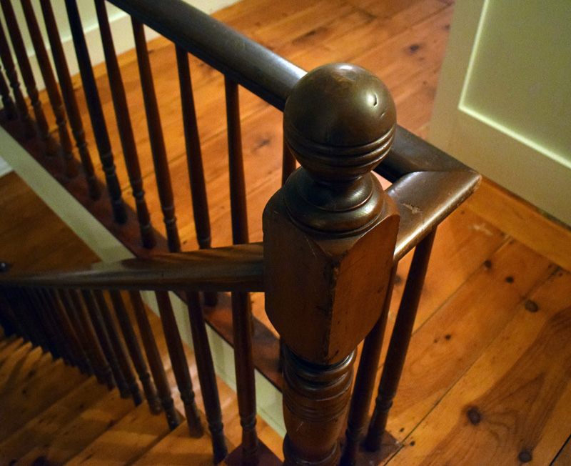 Co-owner of the Harbor View House in Round Pond, Sarah Matel, said the banisters in the 1830s building are original. She said her husband, Jim often muses about how many hands have touched the banister over the years. (Evan Houk photo)