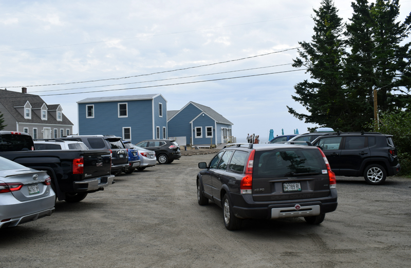 Cars pack the parking lot during the grand opening of the newly constructed SeaGull Gift Shop and Restaurant at Pemaquid Point on Thursday, Sept. 9, exactly one year after the old shop burned down. The Seagull Shop will be open Monday, Thursday, and Sunday from 7:30 a.m. to 5 p.m. and Friday and Saturday from 7:30 a.m. to 8 p.m. (Evan Houk photo)
