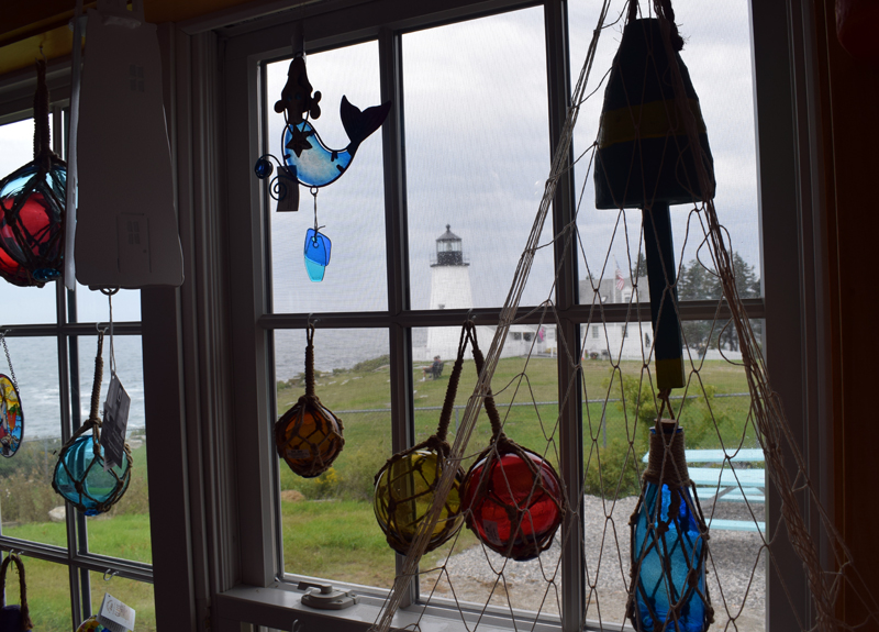 """Pemaquid Point Lighthouse can be seen through the window of newly constructed SeaGull Gift Shop and Restaurant. Co-owner Brooke Cotter said that the gift shop has all of the old inventory as well as some """"new fun stuff."""" (Evan Houk photo)"""