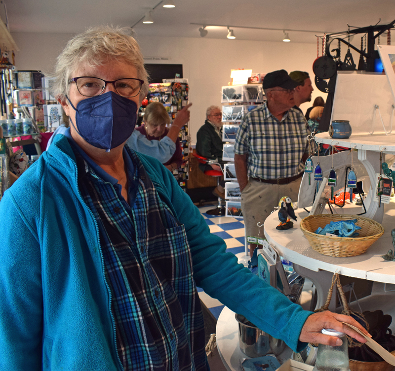 Karen Sunderhauf, who lives right down the road and has been visiting the Seagull Gift Shop and Restaurant at Pemaquid Point since she was four, talks about her memories of the iconic shop during the new building's grand opening on Thursday, Sept. 9, exactly one year after the old building burned down. (Evan Houk photo)