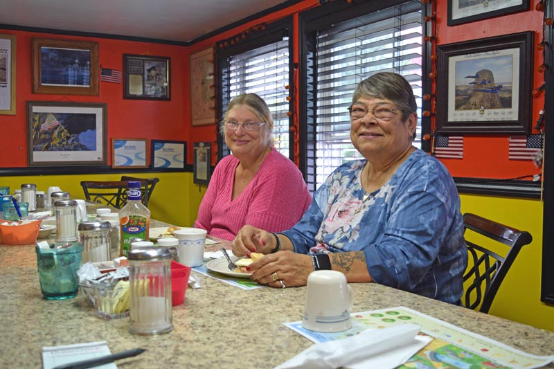 Theresa Williams (left) and Rose Dershaw are long-time customers and eat at the Hot Spot Diner together every Thursday. For breakfast they recommend the  hash and bacon. (Nate Poole photo)