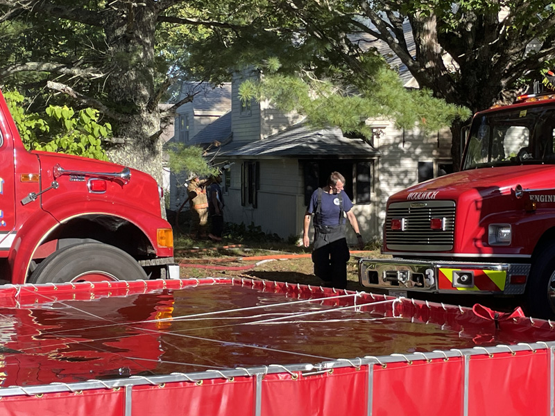A portable water source was used to extinguish a fire at a home on Middle Road in Dresden on Sunday, Sept. 19. (Raye Leonard photo)