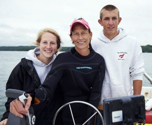Morgan (left), Barb, and Bennett Scully on one of her boats on the Damariscotta River. Both of Barb Scully's children gained valuable experience working for her as crew managers at Glidden Point before moving on to their careers. (Photo courtesy Barb Scully)