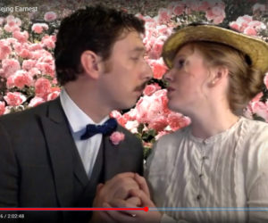 """Soren Barker and Emily Sue Barker play Algernon Moncrieff and Cecily Cardew during the River Company's latest Zoom production of """"The Importance of Being Earnest."""" The actors performed in front of a green screen that has been transformed into a rose garden using a photograph of roses taken at the Coastal Maine Botanical Gardens by photographer Ellie Busby who also plays a role in the production. (screenshot)"""